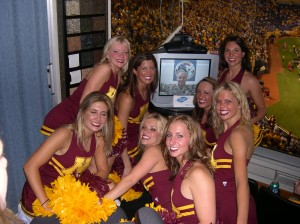 US Marine in Iraq hugs a group of Minnesota Gopher Cheerleaders in a luxury suite at a 2005 football game. Nobody cared who won the game after that.