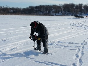 How to make fishing holes on a frozen lake in Minnesota.