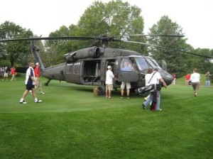 Touring the Blackhawk helicopter in 2009 after a safe landing at Mendakota Country Club.